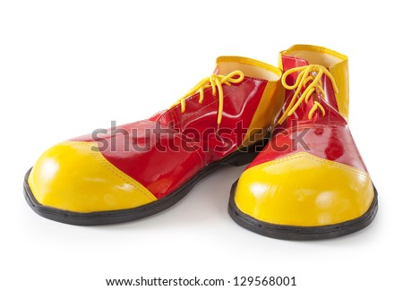 Red and yellow clown shoes isolated on white background - stock photo
