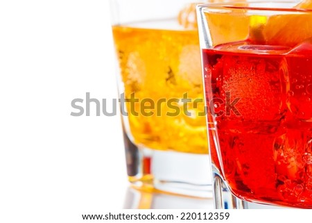red and yellow cocktail with orange slice isolated on white background with space for text - stock photo
