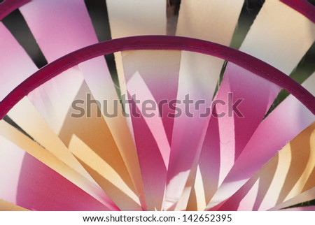 Red and yellow colorful pinwheel. - stock photo