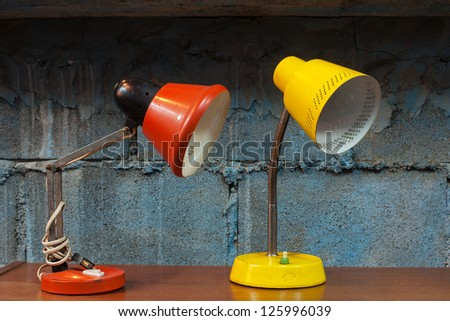 Red and yellow desk lamp in the room - stock photo