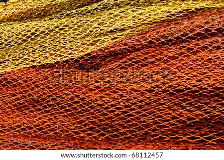 red and yellow fishnet - stock photo