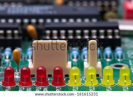Red and Yellow LED on circuit - stock photo