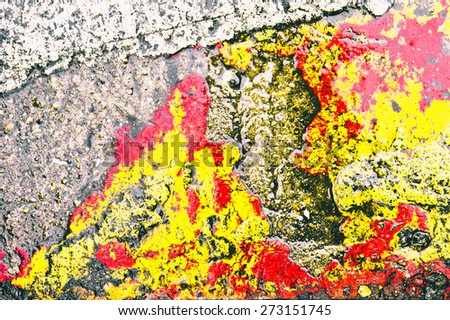 Red and yellow paint on a stone surface as an abstract texture - stock photo