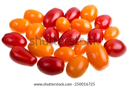 Red and yellow perino tomatoes on a white background - stock photo