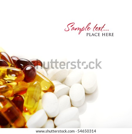 red and yellow pills on white background (shallow DOF) - stock photo