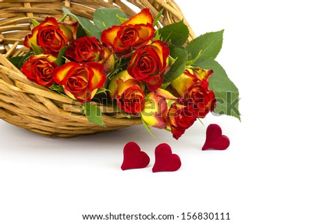 red and yellow roses in a basket