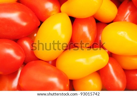 Red and yellow tomato background - stock photo
