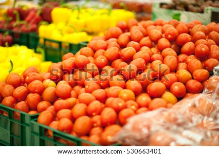 Red and yellow tomatoes background