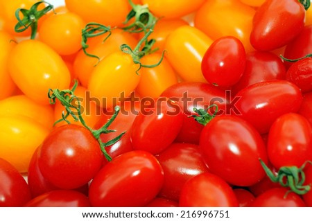 Red and yellow tomatoes cherry as background - stock photo