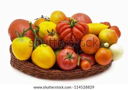 red and yellow tomatoes in a basket - stock photo