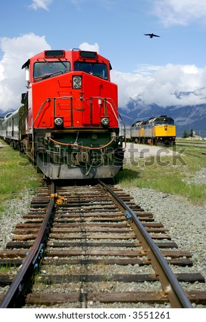 Red and yellow train engines at Jasper, Alberta, Canada - stock photo