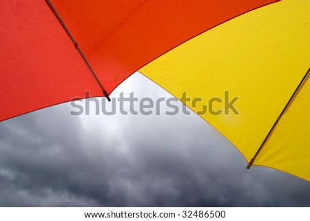 Red and Yellow Umbrellas in the Rain - stock photo