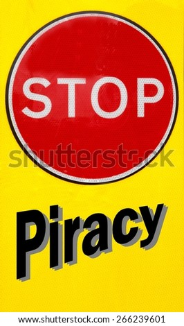 Red and yellow warning sign with a Stop Piracy concept - stock photo