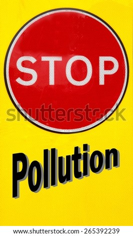 Red and yellow warning sign with a Stop Pollution concept - stock photo