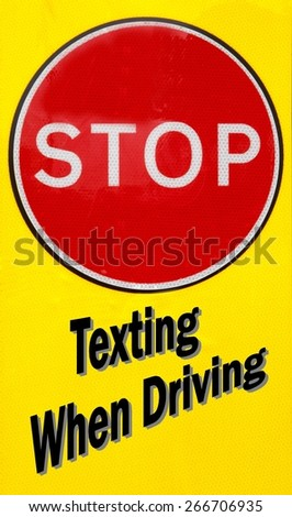 Red and yellow warning sign with a Stop Texting When Driving concept - stock photo
