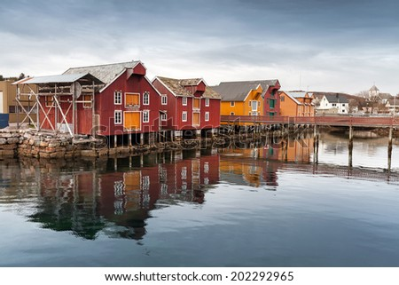 Red and yellow wooden houses in Norwegian village - stock photo