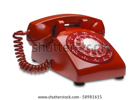 Red angled 60s rotary dial phone isolated with clipping path - stock photo