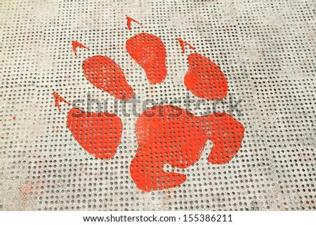 Red animal footprints on rough cement floor background  - stock photo