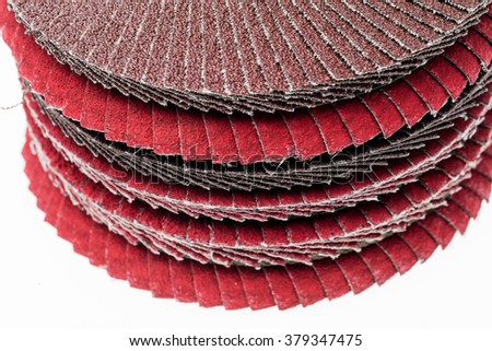 Red ant brown abrasive wheels isolated on a white background.
