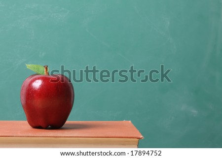 Red apple against a chalkboard background - stock photo