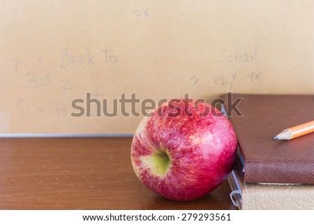 Red apple and book - Concept of education - stock photo