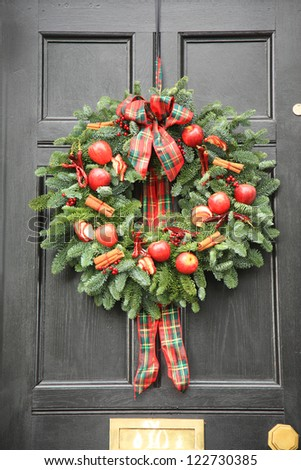 Red apple and chillies Christmas wreath - stock photo