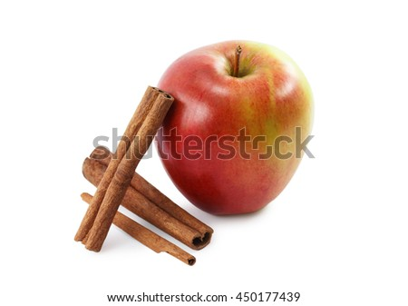 red apple and cinnamon isolated on white background