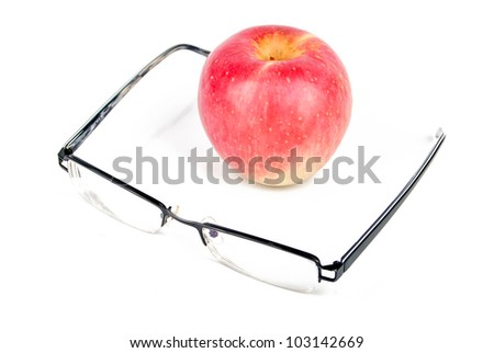 Red apple and eyeglasses