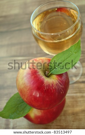 red apple and grapes  on a wooden background