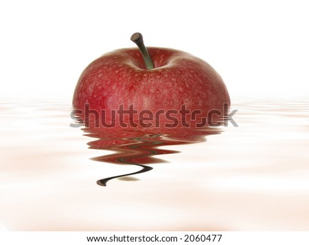 Red apple and its reflection - stock photo