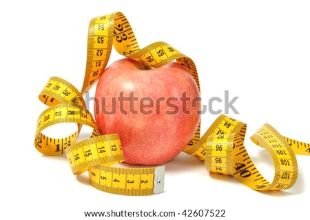 Red apple and measure tape over white