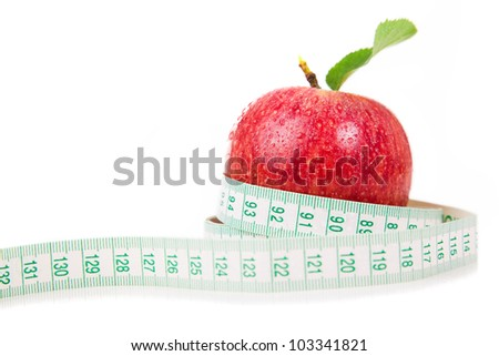 Red apple and measuring tape on a white background.