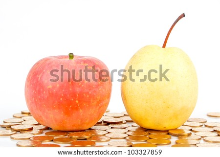 Red apple and pear with coin - stock photo