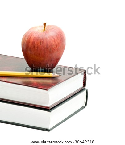 Red apple and pencil on pile of books