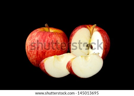 red apple and piece on  black background - stock photo