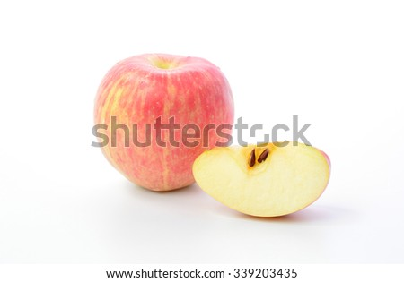 Red apple and slice on a white background
