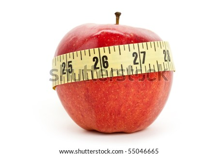 Red apple and Tape Measure close up - stock photo
