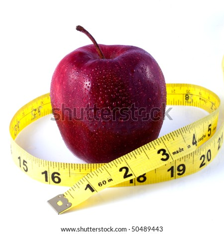 Red Apple and Tape Measure Depicting Weight Loss Concept - stock photo