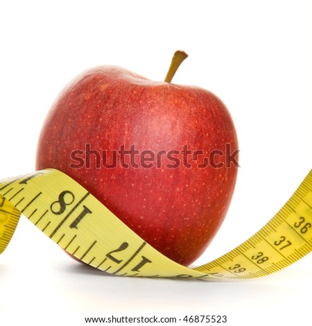 Red apple and tape measure in a square composition with white background - stock photo