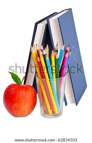 Red apple, books and colored pencil - stock photo