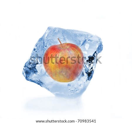 Red apple frozen in ice cube isolated on white background - stock photo