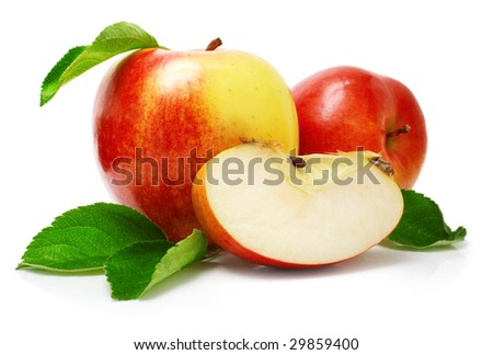 red apple fruits with cut and green leaves isolated on white background