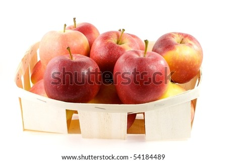 Red apple, in a basket, isolated on white bottom