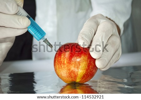 Red apple in genetic engineering laboratory, gmo food concept - stock photo