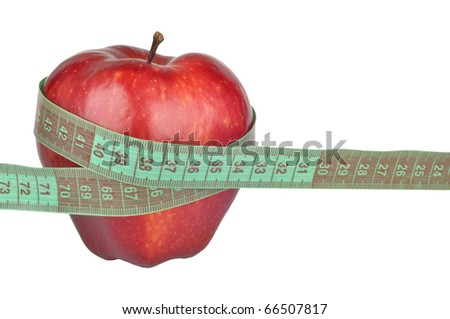 Red apple measured the meter - stock photo