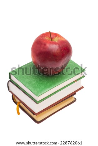 red apple on a books isolated on white  - stock photo