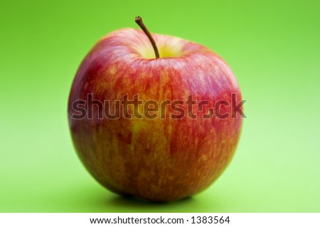 Red apple on a green background - stock photo
