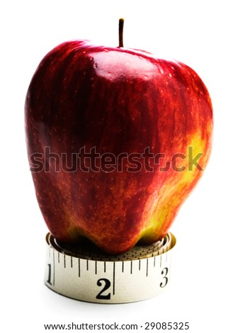 Red apple on a roll of measuring tape isolated over white