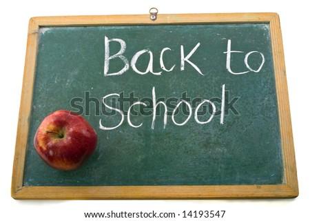 red apple on an old blackboard - stock photo