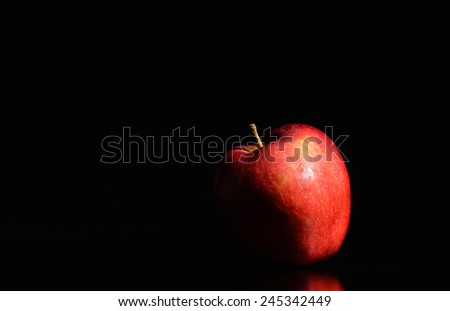Red Apple On Black Background - stock photo